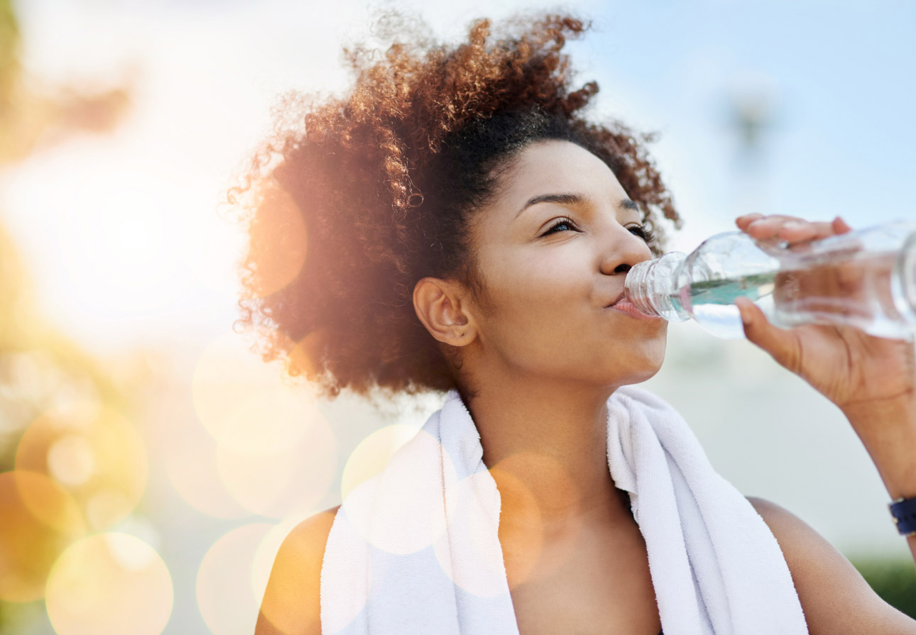 Girl exercising and drinking water